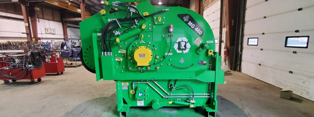 Photo of industrial wood grinder in a shop.